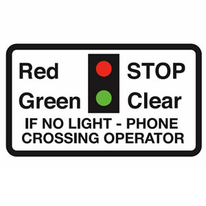 Warning lights at level crossing sign